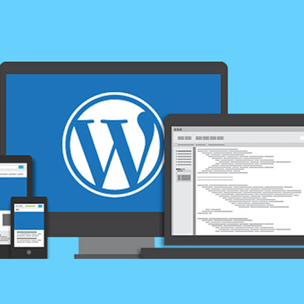 Wordpress website displayed on laptop, large monitor, tablet, and smartphone