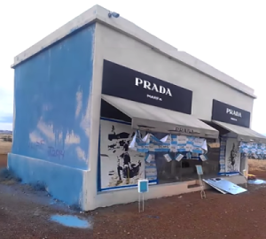 Picture of a store middle of nowhere with Prada logo as storefront